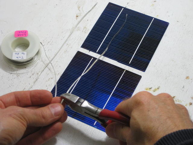 Cutting the strips of tabbing for my DIY/homemade solar panel.