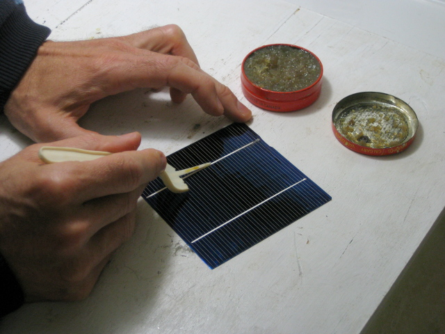 Applying flux paste to the front of a solar cell for my DIY/homemade solar panel.