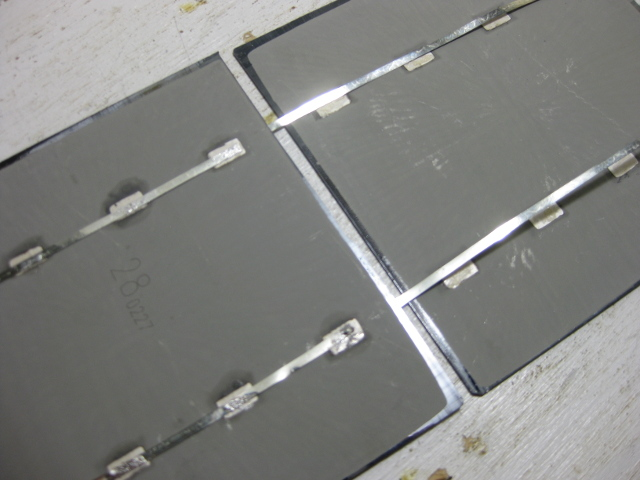 Two solar cells placed near each other in preparation for soldering.