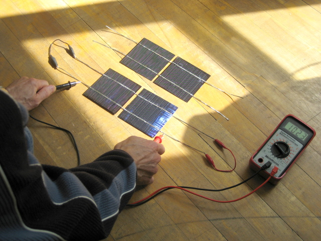 Testing two connected solar cells.